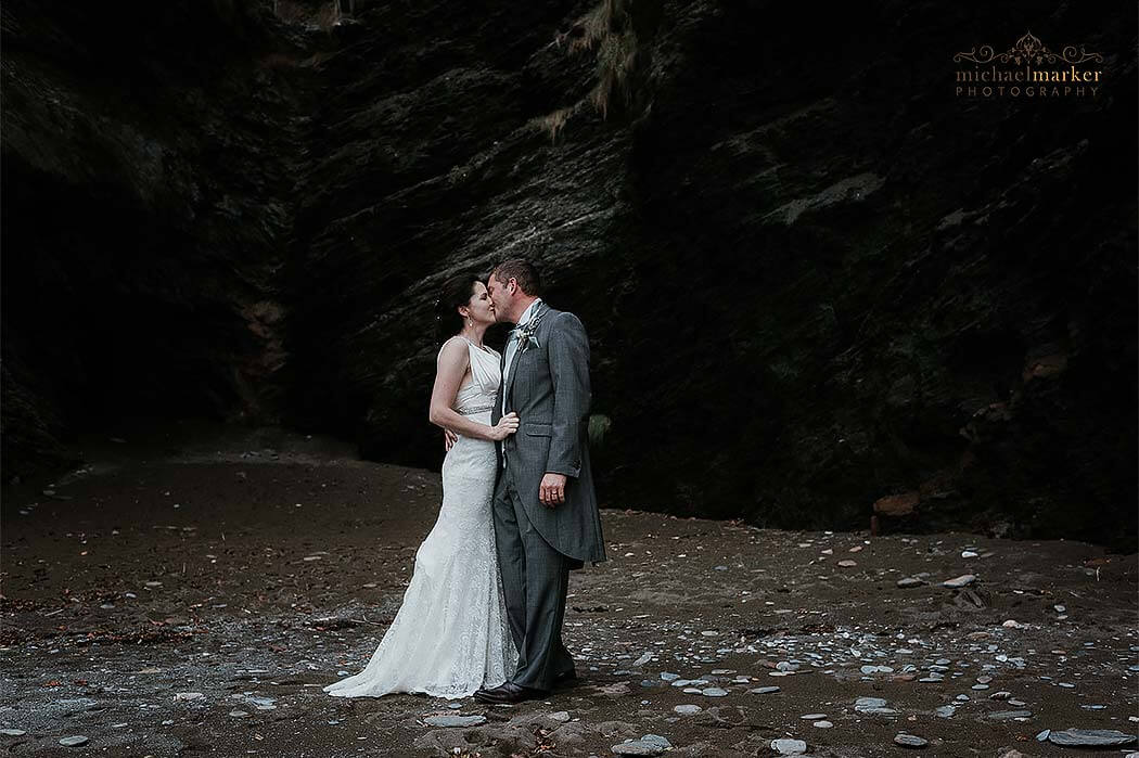 north devon beach wedding kiss