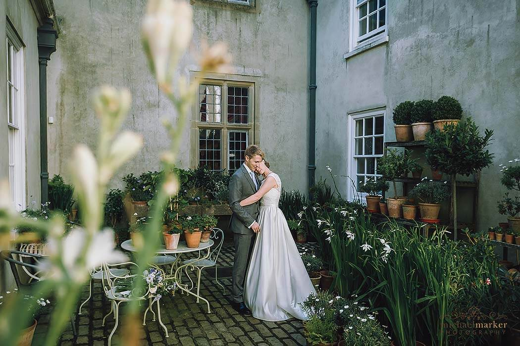 tender wedding moment at Shilstone courtyard