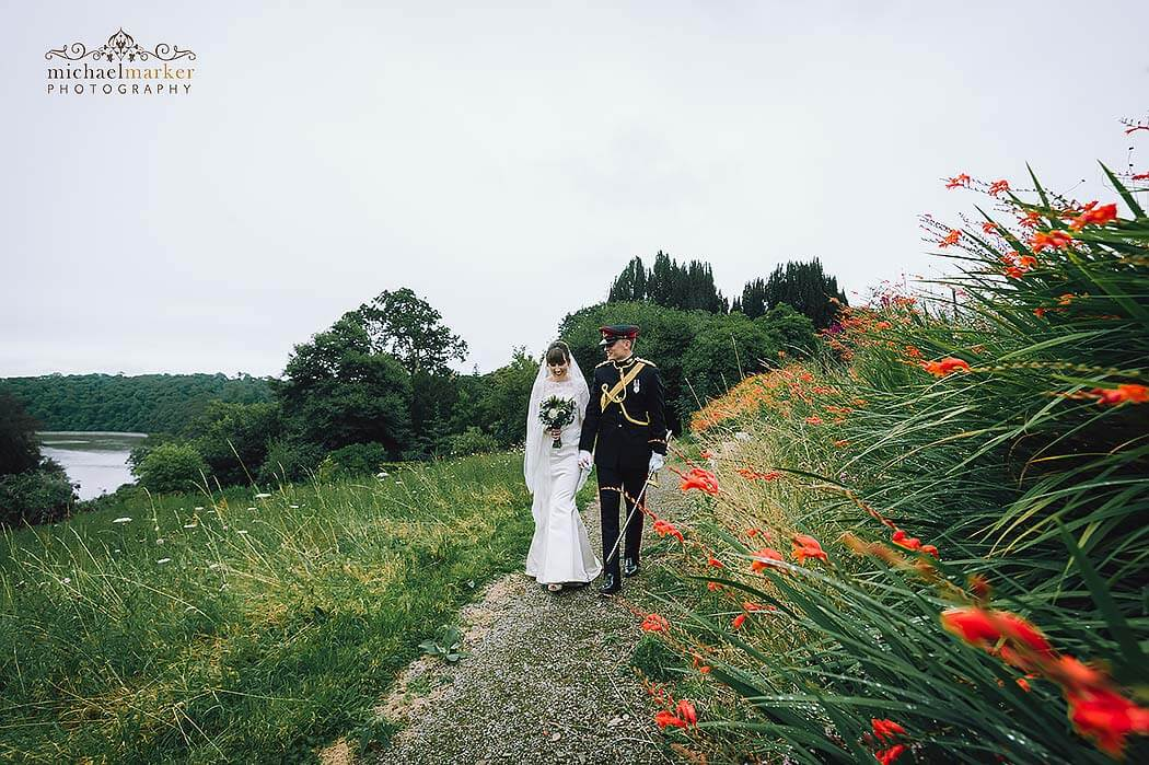 walking in gardens of Pentillie wedding by best Cornwall wedding photographer Michael Marker