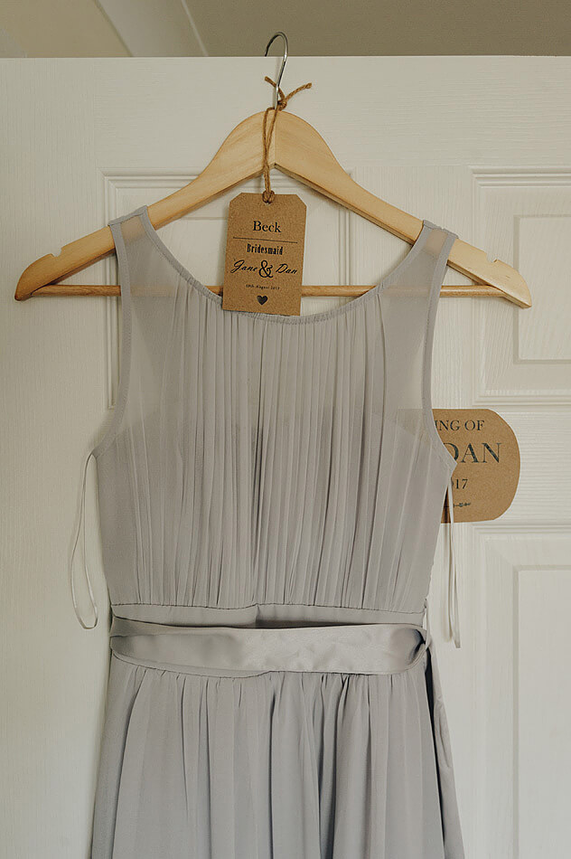Bridesmaid dress and vintage tag hanging up