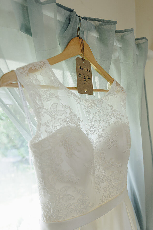 Clsoe up of lace top of wedding dress in devon