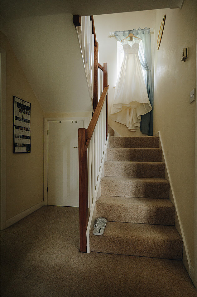 Bride wedding dress on the stairs at home