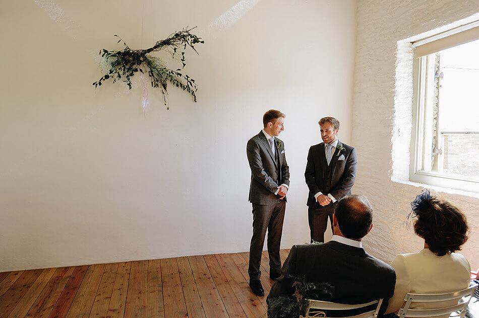 Groom and bestman waiting for the bride at Shilstone House in Devon