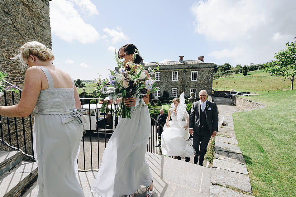 bridal party walking up the steps at Shilstone House