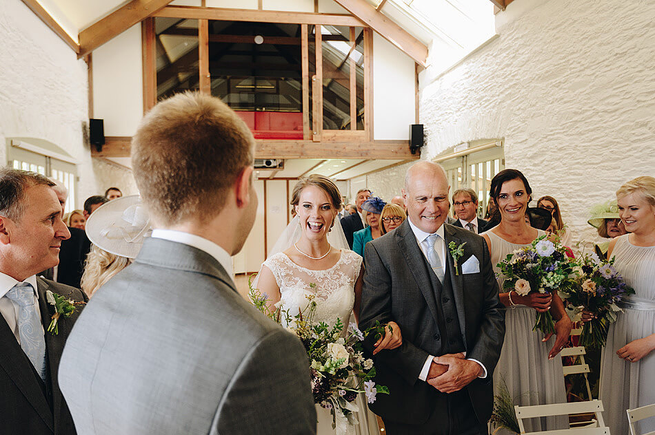 bride excited to see her husband to be at wedding ceremony at Shilstone House