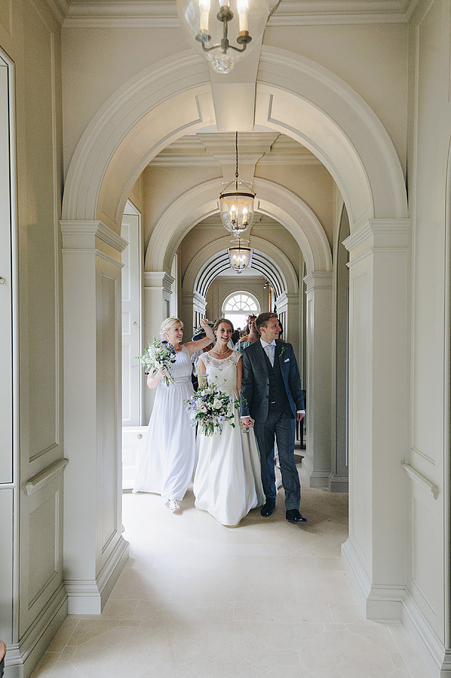 Bridal party in the corridor at Shilstone House wedding venue in Devon