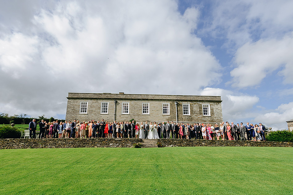 Shilstone house wedding group shot in front of the house