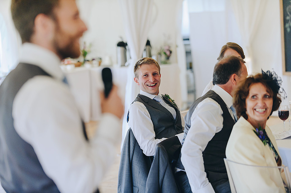 documentary wedding photo of groom laughing during the best man speech at Shilstone House