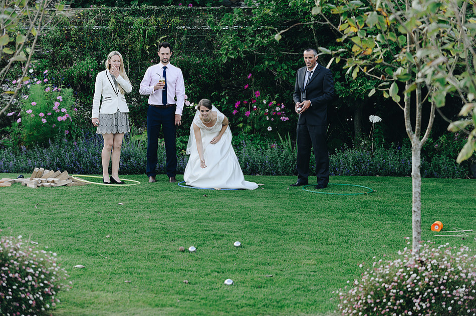 bride playing lawn games boules at Shilstone House wedding