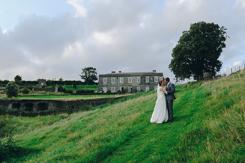 beautiful photo of bride and groom kissing in the fields at Shilstone House in Devon